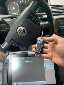 Auto locksmith programming new Mercury car key