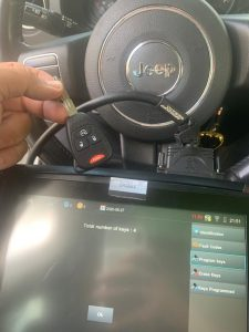 Automotive locksmith coding a new 2015 Jeep Patriot key on-site