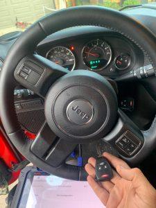 Automotive locksmith coding a new key on-site