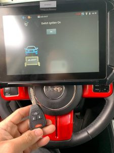 Automotive locksmith coding a new Jeep key on-site