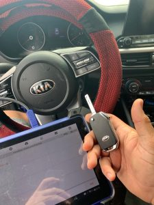 Automotive Locksmith Programming a Kia Mentor Key On-site