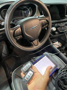 Automotive locksmith coding a new Chrysler Pacifica keys