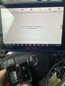 Automotive locksmith coding new Acura key fobs on-site