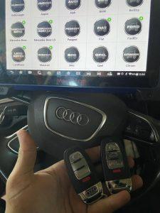 Coding key fobs (Audi) on-site by an automotive locksmith