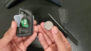Inside look of a Cadillac key fob and battery