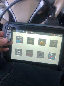 Automotive locksmith for Nissan car cut and program new key fob