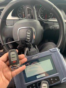 Automotive locksmith coding a new Audi key fob on-site