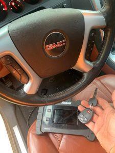 Automotive locksmith coding a new transponder GMC key