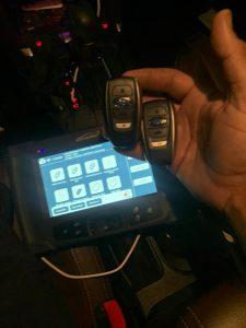 Automotive locksmith coding a new Subaru key fob on-site