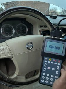 Automotive locksmith coding a new Volvo key fob on-site