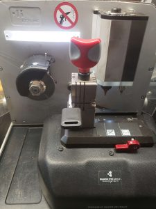 Cutting machine used by an automotive locksmith to cut key at your location