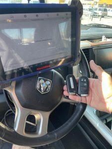 Automotive locksmith coding a new Dodge Ram key fobs