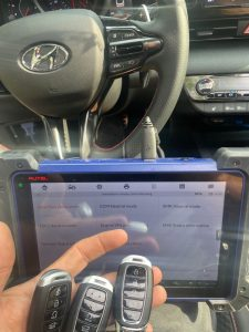 An automotive locksmith coding new Hyundai key fobs
