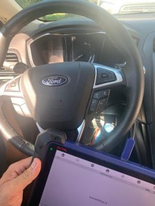 Both the dealer and an automotive locksmith can code you a new Ford key fob