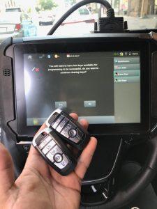Automotive locksmith coding machine and key fobs