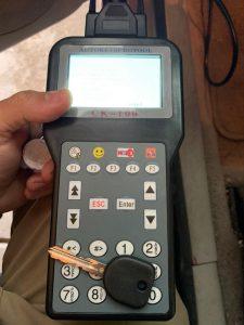 Automotive locksmith coding a new Hummer key on-site