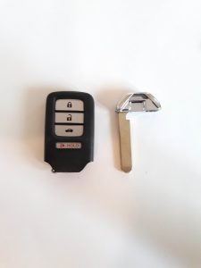 Key fob and the emergency key to unlock the door