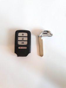 Key fob and emergency key to unlock the door