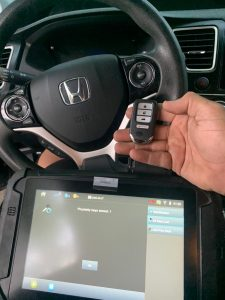 Automotive locksmith coding a new Honda key fob