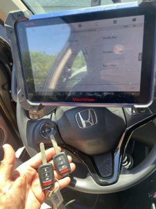 Automotive locksmith coding a Honda Civic key