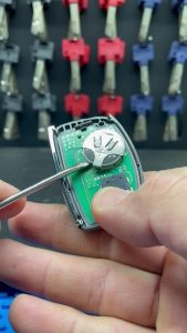 The key fob on the inside - battery and chip