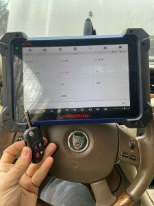 Automotive locksmith coding a new Jaguar transponder key on-site