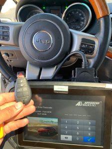 Automotive locksmith coding a new Jeep fobik key