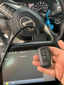 Automotive locksmith coding a new Lexus key on-site