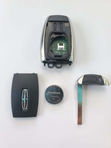 Inside look of Lincoln key fob, battery and emergency key