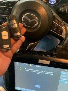 Automotive locksmith coding new Mazda key fobs