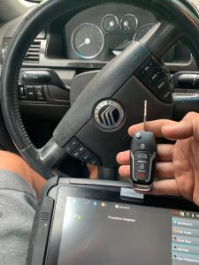 Automotive locksmith coding a new Mercury key on-site