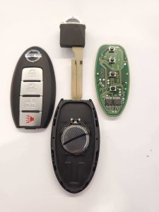 Inside look of Nissan key fob and emergency key