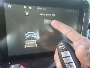 Automotive locksmith coding a new Nissan key fob on-site