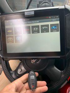 Automotive locksmith coding a new Nissan key fob