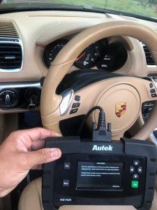 Automotive locksmith coding a new Porsche key