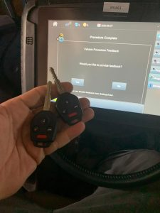 Locksmith cutting new Subaru keys on-site, including programming