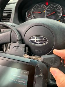 Automotive locksmith coding a new Subaru key on-site