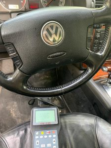 Automotive locksmith coding a new Volkswagen car key on-site