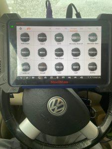 Automotive locksmith coding machine for VW car keys and key fobs