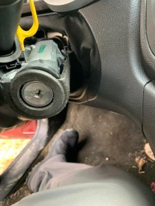 Automotive locksmith replacing a new ignition cylinder