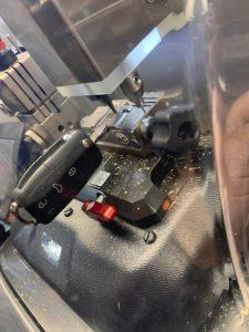 Automotive locksmith cutting a new VW flip key on-site