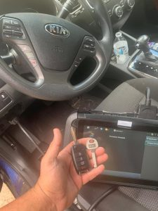 Automotive locksmith coding new Kia keys on-site