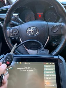 Automotive locksmith coding a Toyota replacement key